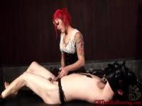 Tattooed redhead mistress Goddess Soma is playing a huge rod