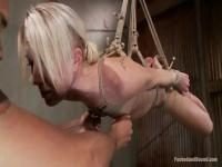 Sexy young blonde girl tied up good and tight