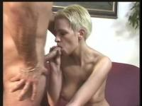 Short haired German gal is sucking a huge penis