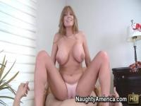 Darla Crane's hooters bounce while she rides a meat pole