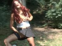 Redhead whore will play her pussy outdoors