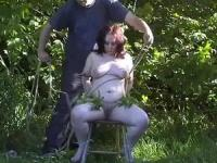 Chubby mature slave is bound to a chair