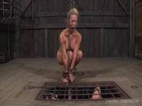 Cherie Deville on top of the cage of Lavender Rayne