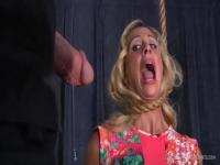 Cherie Deville hanging from her neck by a noose
