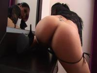 Hot brunette masturbates in front of the mirror