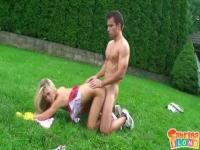 Sabrina Blond gardening in a schoolgirl dress