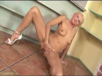 Sexy mum is fingering her pussy at home