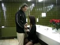 Hot brunette gets fucked in a public toilet
