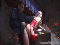 A wild cult member fucks a slut in a dungeon