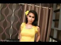 Ladyboy Gor in a yellow dress clip1