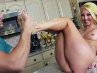 Wife enjoys fucking on the counter with the mate licking her feet