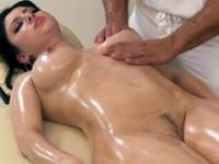 Hot brunette receiving special treatment from her masseur