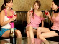 Three hot chicks are drinking and undressing in the bar