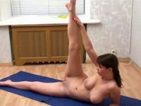 Sportive gal having yoga session while being completely naked