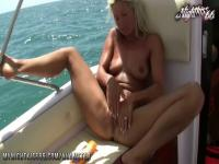 Nude blonde cougar plays with her slit on the boat