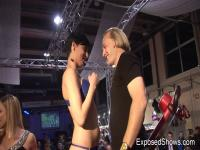 Hawt floozy playing with a rock hard strapon at the sex show