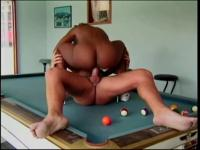dark floozy takes it hard on a pool table