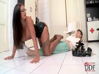 Huge brunette bitch Emma Butt is wearing sexy leather corset and high heel shoe and scoffing on her boyfriend.