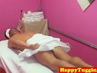 Asian masseuse tugging her clients dick