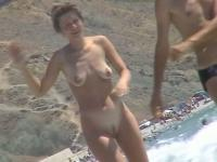 Short-haired girl with trimmed pussy relaxing at the nudist beach