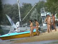 Hot beach voyeur video shows mature nudists enjoying each others company.