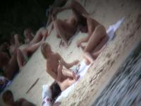 Nudist couples video clip by a hidden beach camera