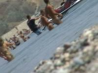 lots of very sexy naked babes on the nudist beach getting wet