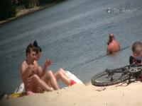 Flat chested brunette and mature blonde on beach voyeur vid