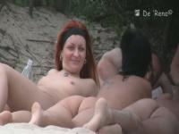 Hot tattooed redhead filmed on a nudist beach