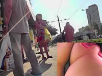 Outdoor upskirt scene filmed at the local bus stop