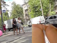 Upskirt treasures of the young girl walking with a gf