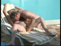 Mom and dad having fun near swimming pool. Hidden cam