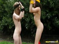 Skinny teens play naked fantasy football in public