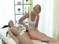 A masseuse gives her client's pussy a rub down