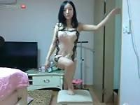 Hot Korean chick performs striptease