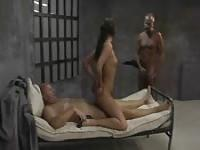 Young hooker pleasuring two old prisoners