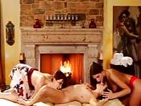 Lesbian threesome by the fireplace