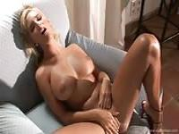 Impressive blonde pleasing herself