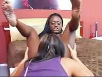 Busty ebony MILF and her girlfriend playing
