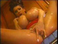 Breasty lady soaps up and pleasures herself