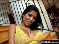 The horny, big boobed Latina Alexis Amore, sits on her stairs wearing only