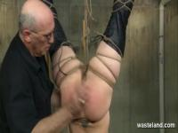 Bound slave suspended upside down gets caned and spanked by Master