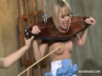 Sexy blonde sex slave teased and pleased in dungeon by lesbian Mistress
