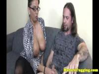Busty spex milf gets cumshot after handjob