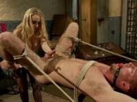 Busty blonde strapon-fucks a tied dude