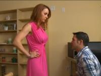 Redhead secretary with huge jugs has oral sex