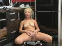 Golden-haired mature maid is acting in striptease porno movie