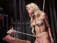 Blonde Carmen Caliente is acting in bondage porno movie