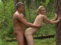 Blonde beauty rides a cock in the woods