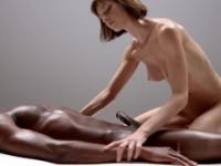 Skinny redhead masseuse sucks a black dick